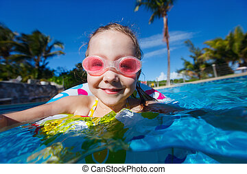 Little girl in swimming pool - Adorable little girl at...