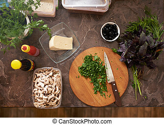 chopped parsley on board with other ingredients - chopped...
