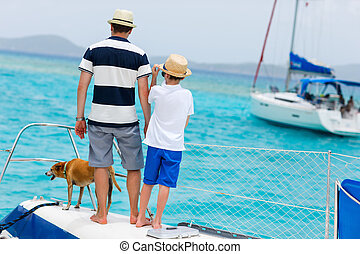 Family sailing on a luxury yacht - Father, son and their pet...
