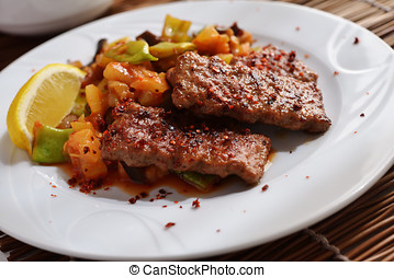 Adana kofte with vegetables - Adana kofte with roasted...