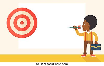 Working black man holding a target arrow - A working black...