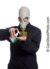 Hand Sanitizer - A young man wearing a breathing apparatus...