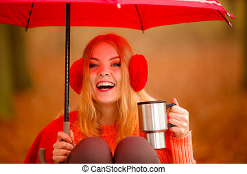 Girl in autumn park enjoying hot drink - Happiness carefree...