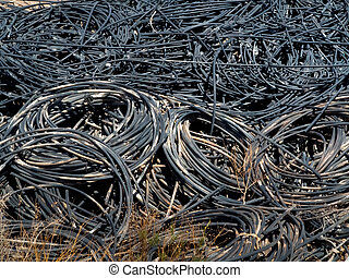 Piles of waste cables at junkyard