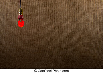 Hanging Red CFL Bulb Background - Single hanging red CFL...