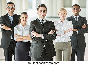 Business conference - Handsome boss standing in a modern...