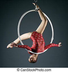 Lovely gymnast performs acrobatic stunt on hoop - Studio...