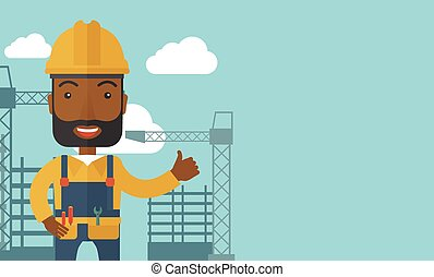 Black man standing infront of construction crane tower. - A...