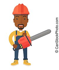 Black Lumberjack cuts a tree by chainsaw. - A black...