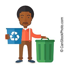 Black man sorting a trash - A black man standing outside the...
