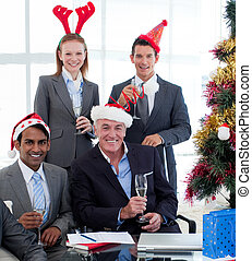 Business team celebrating Christmas in the office