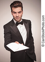 Attractive young business man offering you a invitation. -...