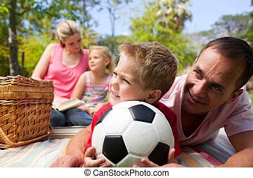 Father and son holding soccer ball
