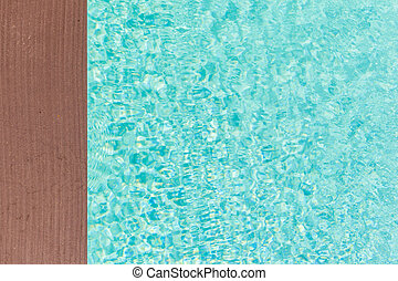 Wooden pool side - wooden planks at the pool side with...