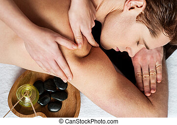 Massage make me more relax - Man enjoying a wellness back...