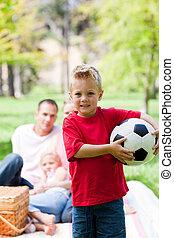 Little boy holding a soccer ball