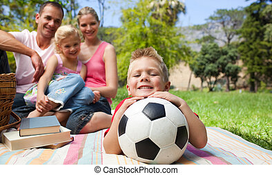 Smiling boy holding a soccer ball
