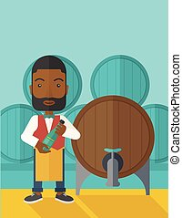 African Wine maker inspecting wine from barrel. - An african...