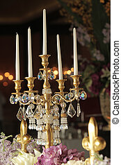 Candlesticks retro style on table with flower
