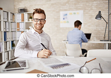 White collar worker - Successful young businessman sitting...