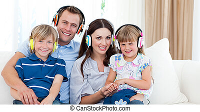 Adorable family listening to music - Adorable family...