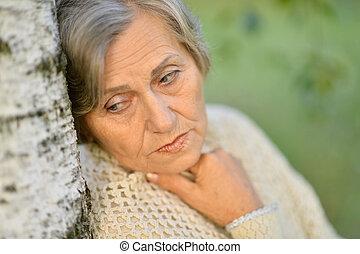 Old Lady Near The Tree - portrait of an elderly lady near...