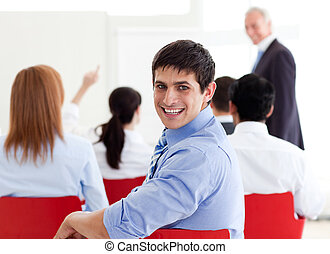 A diverse group of business people at a seminar in the...
