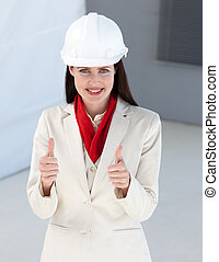 Close-up of a female architect with thumbs up