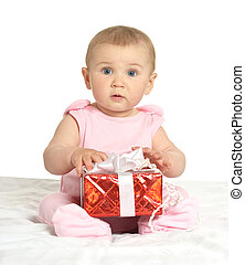 Baby girl sitting with gift - Portrait of Cute baby girl...