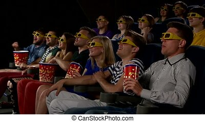 Young people watch movies in cinema: comedy in 3D - Young...