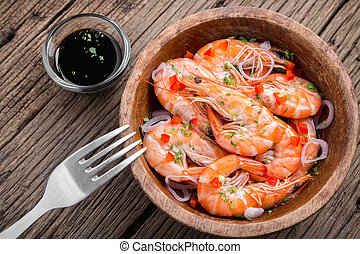 shrimps - steamed shrimps in a wooden bowl on wood...