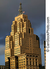 Historic tall building in Detroit downtown against cloudy...