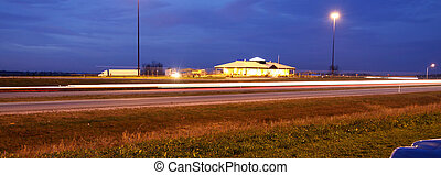 Night landscape on high way - Illuminated rest area by the...