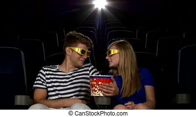 Great movie Young couple feeding each other at the cinema 3D...