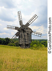 old windmill in museum Pirogovo, Ukraine - Old wooden...