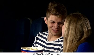 couple feeding each other at the cinema. Close up - Great...