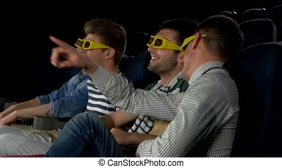 Young friends watching a film at the cinema. Close Up, 3D...