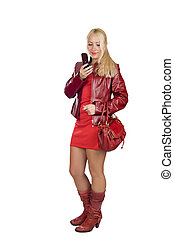 Sending sms - Stylish young woman wearing red closes dialing...