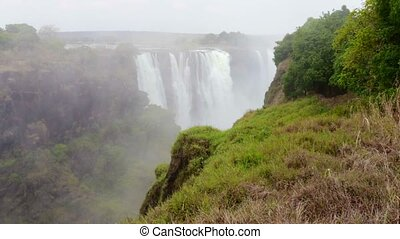 The Victoria falls with mist from w - The Victoria falls is...