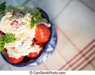Strawberry wuth whipped cream in traditional russian plate -...