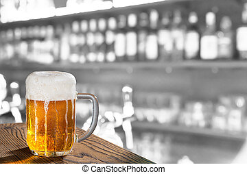 glass of beer in the pub - a pint in the pub, composite...