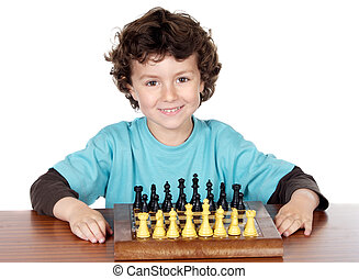 boy playing the chess - adorable boy playing the chess a...