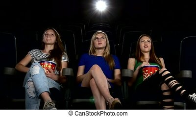 Cute girl watching movie in cinema theater exciting moment -...