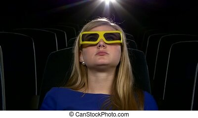 Attractive young girl in 3D at the cinema. eating popcorn. Close up