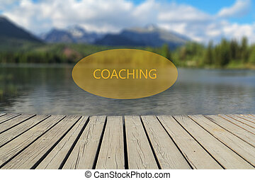 concept of coaching, mountain lake in the background