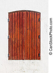 wooden shutter on a white wall
