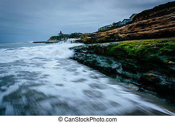 Waves crashing on rocks at Natural Bridges State Beach, in Santa Cruz, California.