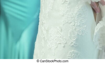Lacing wedding dress - Mother of the Bride helps lace...