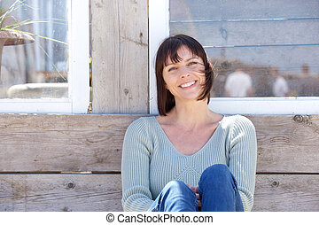 Happy middle aged woman smiling outdoors - Close up portrait...