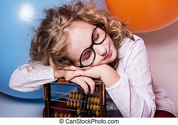 Portrait of girl dreaming in glasses with eyes closed...